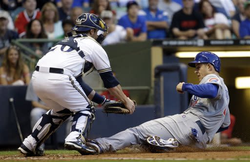 Milwaukee Brewers catcher Jonathan Lucroy tags out Chicago Cubs' Anthony Rizzo during the third inning of a baseball game Wednesday, June 26, 2013, in Milwaukee. Rizzo tried to score from third on a fly ball by Darwin Barney. (AP Photo/Morry Gash)