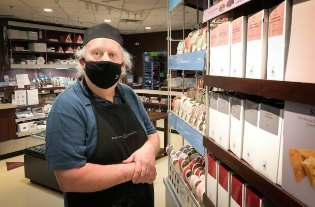Sam Boutilier owns the Rocky Mountain Chocolate Factory outlet in Sydney. The U.S.-based confections chain has locations around the world. (Tom Ayers/CBC - image credit)