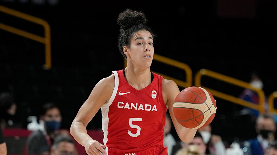 Canada's Kia Nurse brings the ball up the court during Olympic action in Tokyo. (AP Photo/Eric Gay)