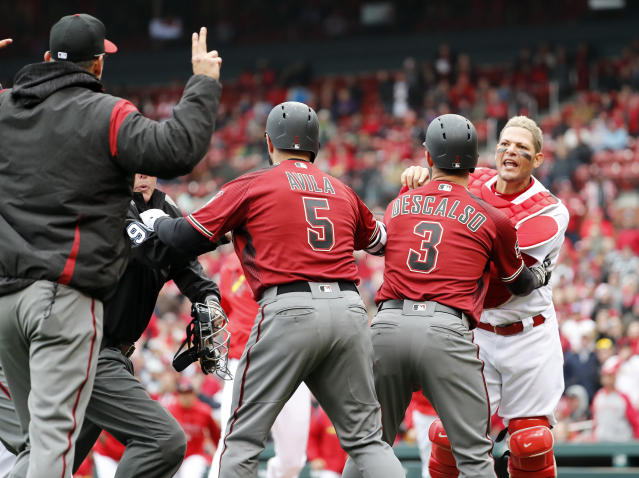 Yadier Molina and Torey Lovullo were suspended for their actions during an altercation. (AP Photo/Jeff Roberson)