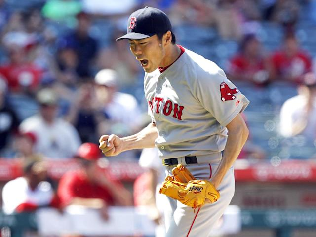 Red Sox closer Koji Uehara reacts after striking out the Angels' Josh Hamilton on Sunday. (AP Photo)