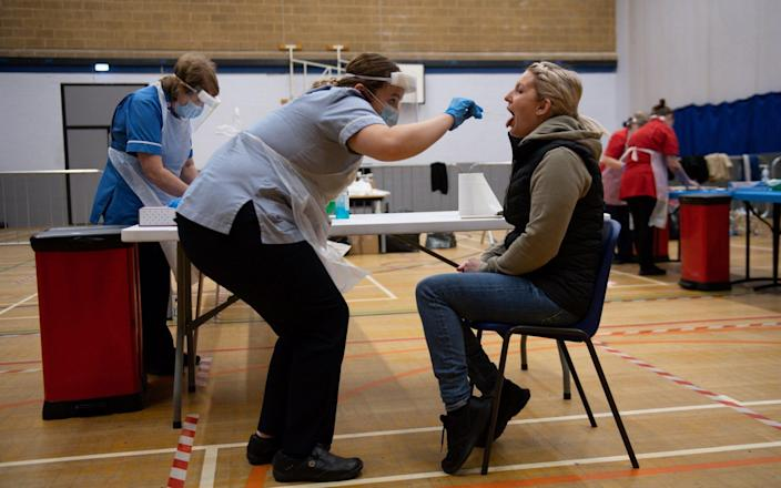 A nurse administers a test in Stoke-on-Trent during a testing session using the newly-supplied lateral flow Covid-19 tests - Jacob King /PA