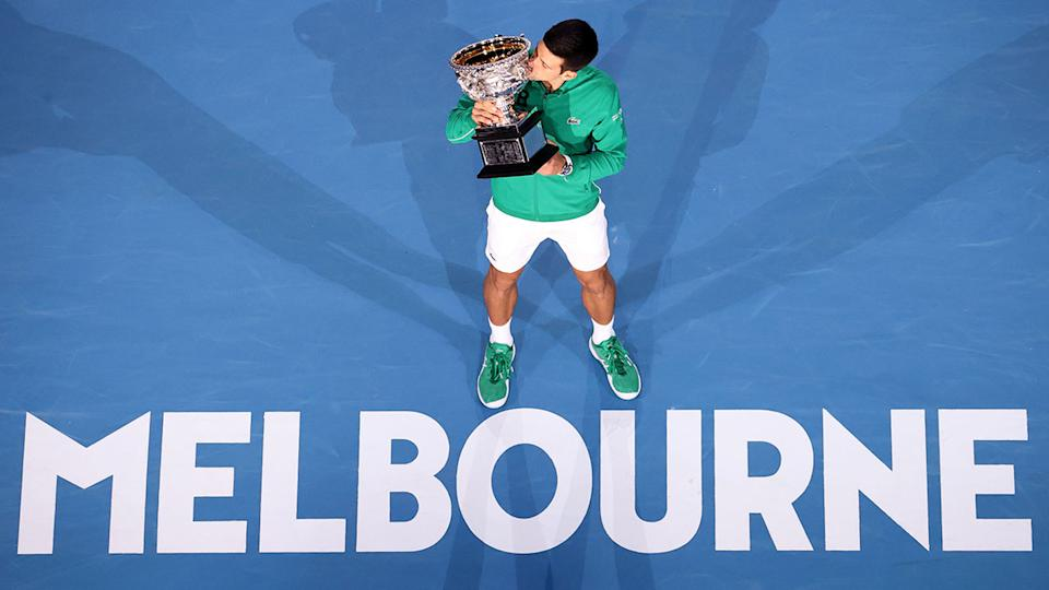 Pictured here, 2020 Australian Open champion Novak Djokovic poses with his trophy.