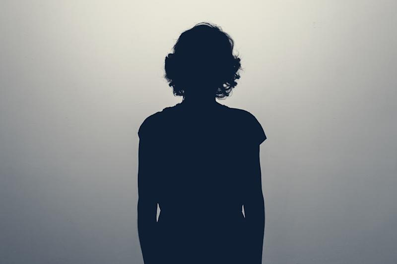 Unknown female person silhouette in studio. Concept of depression, stress or anonymous