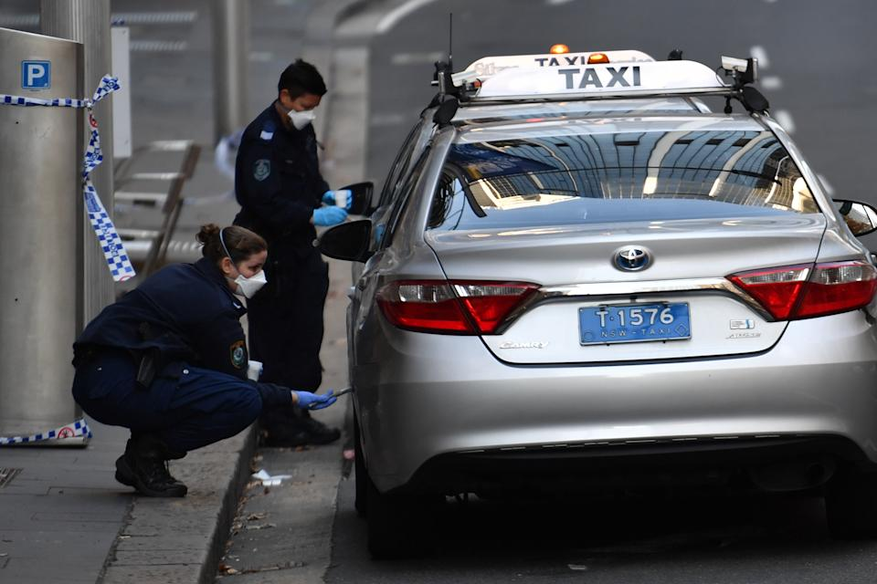 Police dust for fingerprints at the scene of a fatal shooting on Bridge Street in the CBD. Source: AAP