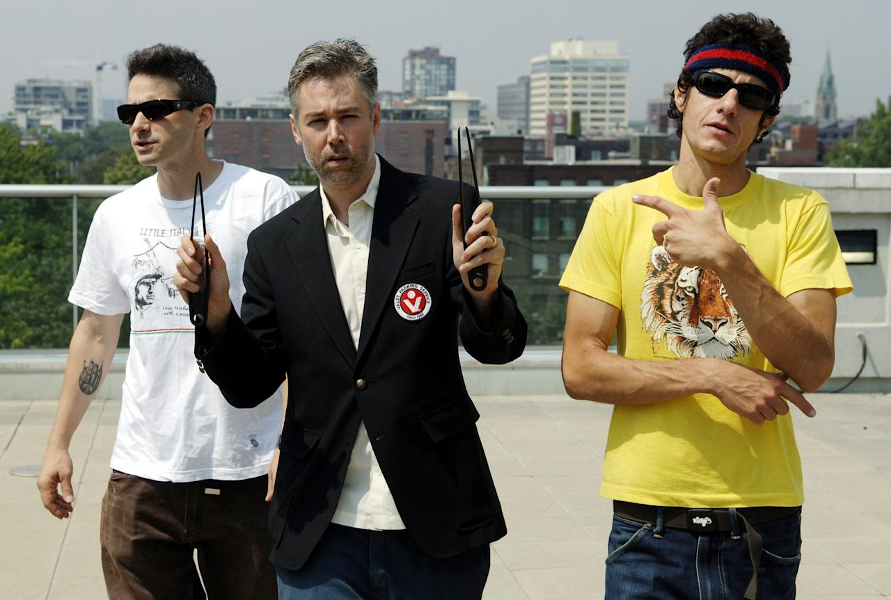"""FILE - In this July 26, 2006 file photo, Beastie Boys members Adam Yauch """"MCA,"""" center, Adam Horovitz """"Adrock,"""" left, and Mike Diamond """"Mike D,"""" reflected in a mirror, pose for a photograph during an interview in Toronto, Wednesday, July 26, 2006. Yauch, the gravelly voiced Beastie Boys rapper who co-founded the seminal hip-hop group, has died at age 47. The cause of death wasn't immediately known. Yauch, who's also known as MCA, was diagnosed with a cancerous parotid gland in 2009. (AP Photo/The Canadian Press, Aaron Harris)"""