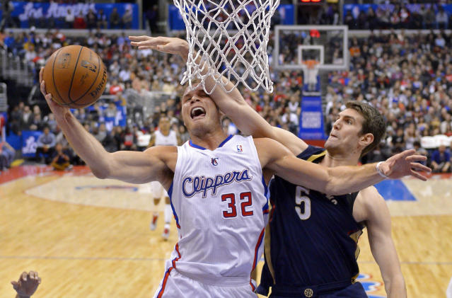 Los Angeles Clippers forward Blake Griffin, left, shoots as New Orleans Pelicans center Jeff Withey defends during the first half of an NBA basketball game, Saturday, March 1, 2014, in Los Angeles. (AP Photo/Mark J. Terrill)