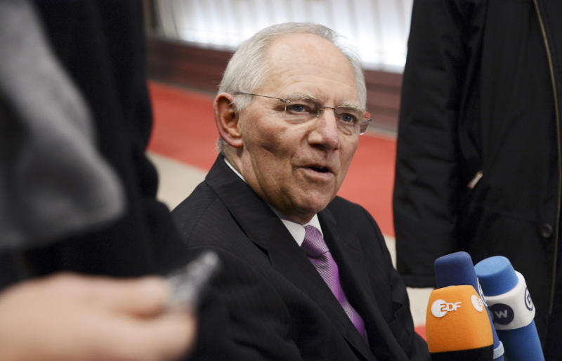 German Finance Minister Wolfgang Schaeuble speaks with the media prior to a meeting of eurogroup finance ministers in Brussels on Tuesday, Nov. 20, 2012. European Union officials will make a fresh try Tuesday to reaching a political accord on desperately needed bailout loans to Greece, an agreement that eluded them last week. (AP Photo/Thierry Charlier)