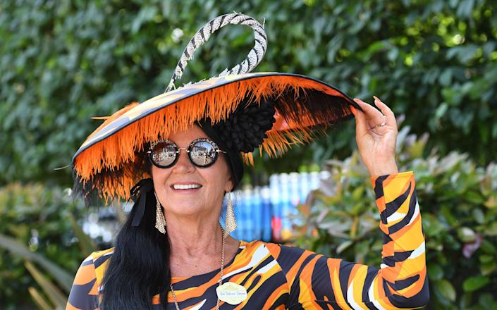 <p>A racegoer attends the first day off Royal Ascot 2017 at Ascot Racecourse on June 20, 2017 in Ascot, England. (Anwar Hussein/WireImage via Getty Images) </p>