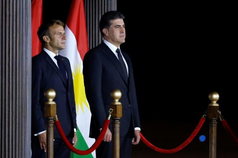 French President Emmanuel Macron (L) stands with President of Iraq's autonomous Kurdistan Region Nechirvan Barzani during a welcome ceremony at Arbil Airport in Arbil, the capital of Iraq's northern autonomous Kurdish region (AFP/Ludovic MARIN)