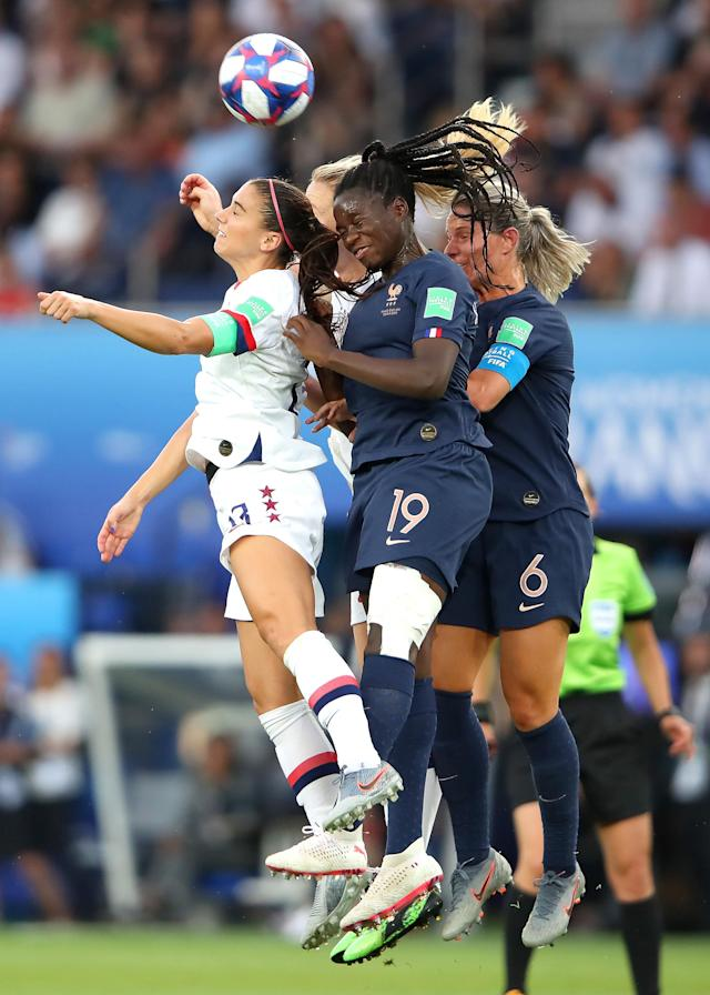 Alex Morgan of the USA jumps for the ball with Griedge Mbock Bathy of France during the 2019 FIFA Women's World Cup France Quarter Final match between France and USA at Parc des Princes on June 28, 2019 in Paris, France. (Photo by Alex Grimm/Getty Images)