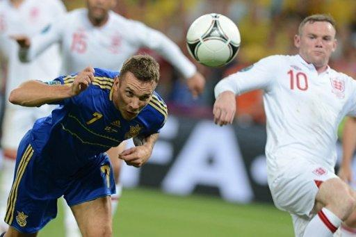 Ukrainian forward Andrei Shevchenko (L) heads the ball during the Euro 2012 football championships match England vs Ukraine at the Donbass Arena in Donetsk. England scraped into the quarter-finals of Euro 2012 here Tuesday after a goal-line refereeing blunder helped them to a 1-0 win over Ukraine which sent the co-hosts crashing out