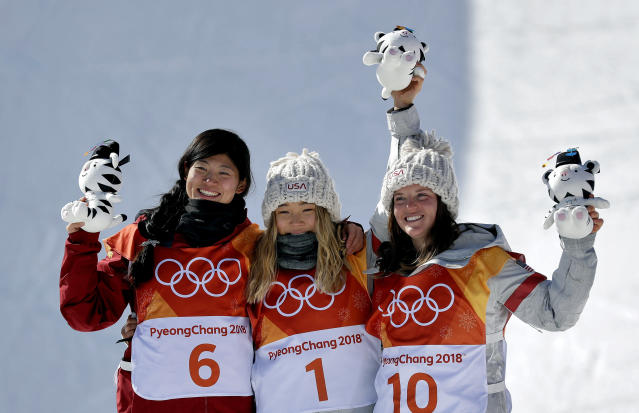 Chloe Kim, Liu Jiayu and Arielle Gold pose with their stuff animals after the women's halfpipe. (AP Photo)