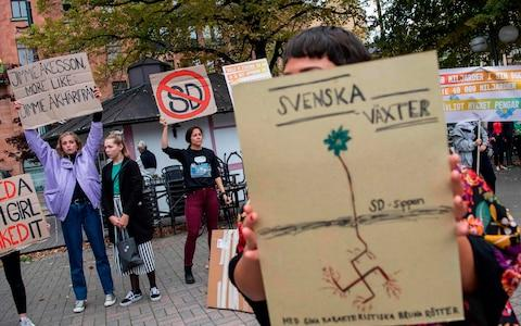People demonstrate against Sweden Democrats and its party leader Jimmie Akesson - Credit: JONATHAN NACKSTRAND/AFP