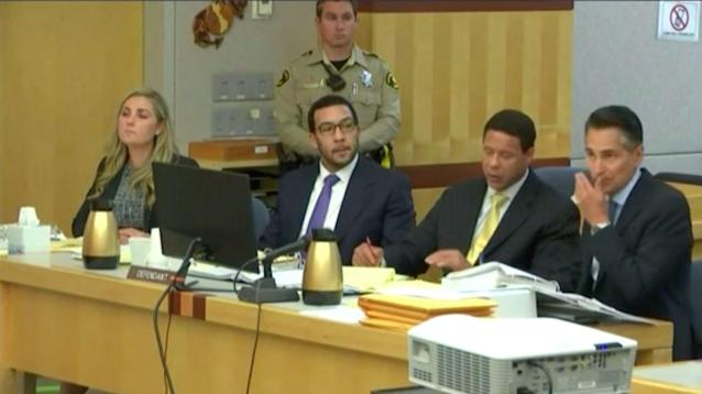 Kellen Winslow, middle left, sits with his attorneys during Day 3 of his rape trial. (CourtTV)
