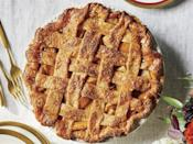 """<p>We found the ultimate apple pie in the most unexpected place. When customers walk through the door of <a href=""""https://www.southernliving.com/bbq/ashevilles-buxton-hall-blends-old-new"""" rel=""""nofollow noopener"""" target=""""_blank"""" data-ylk=""""slk:Buxton Hall Barbecue"""" class=""""link rapid-noclick-resp"""">Buxton Hall Barbecue</a> in Asheville, North Carolina, they are greeted not just by the sweet smell of smoke of whole hogs cooking over oak and hickory wood, but also by """"the pie table"""". Ashley Capps, the pastry chef behind the restaurant's in-house Buxton Hall Bakery, crowns the long table's vintage stands with flavors like Caramel Walnut Chess and her sell-out hit Banana Pudding Pie. Capps' developed the Ultimate Apple Pie to include fresh and dried fruit along with apple butter for a deep flavor and engaging texture. This recipe is perfect for fall, but even better on Thanksgiving. Bake a <a href=""""https://www.southernliving.com/food/holidays-occasions/thanksgiving-pies"""" rel=""""nofollow noopener"""" target=""""_blank"""" data-ylk=""""slk:few different pies"""" class=""""link rapid-noclick-resp"""">few different pies</a> this year and set up your own pie table.</p> <p><a href=""""https://www.myrecipes.com/recipe/buxton-hall-ultimate-apple-pie"""" rel=""""nofollow noopener"""" target=""""_blank"""" data-ylk=""""slk:Buxton Hall Ultimate Apple Pie Recipe"""" class=""""link rapid-noclick-resp"""">Buxton Hall Ultimate Apple Pie Recipe</a></p>"""