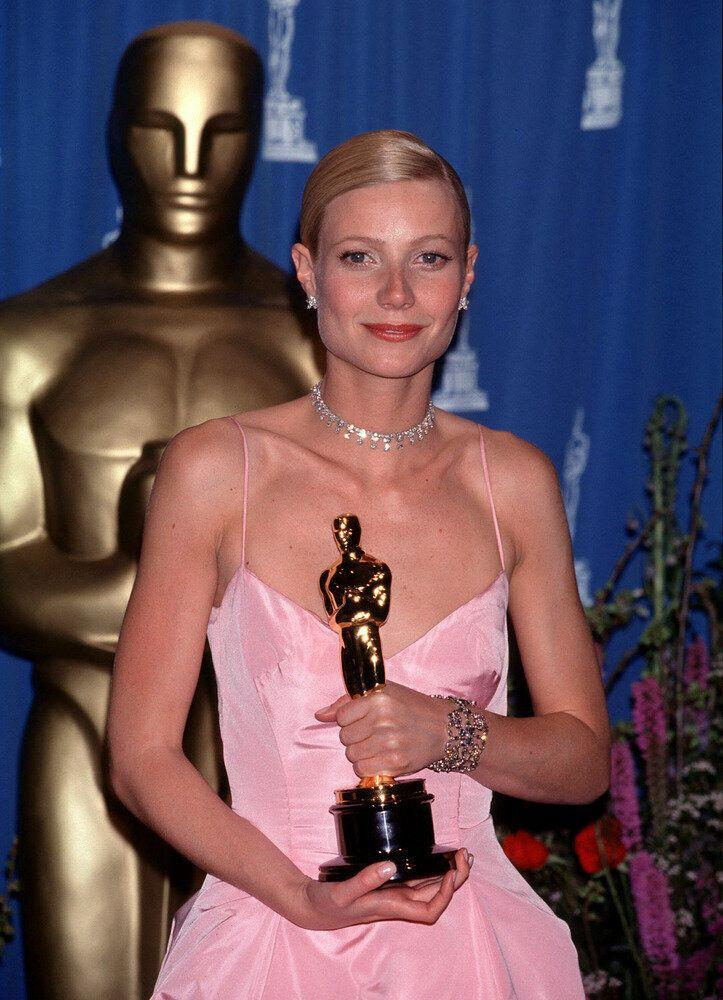"Gwyneth holding her statue after winning Best Actress for ""Shakespeare In Love"" at the 71st Academy Awards."