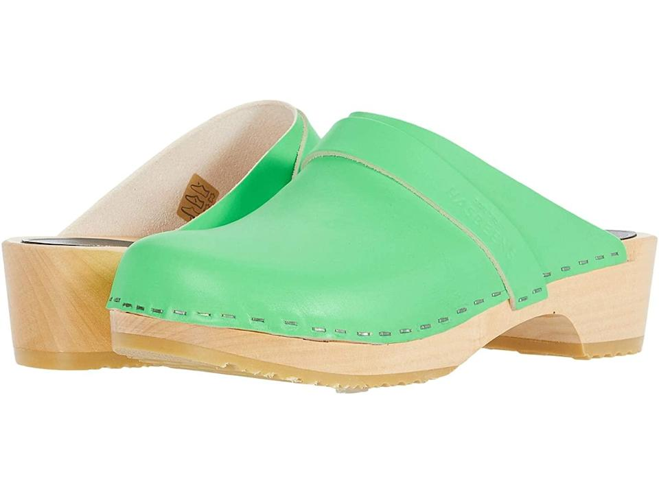 """<h2>Clogs <br></h2><br>Last but not least, the slip-on shoe that became our standby during the endless housebound weeks of 2020 is ready to accompany us outside — and it's popping up in colors and fabrication that beg to be seen. The growing clog-session with this grounded shoe, explains Theobalds, """"is rooted in a return to the classics. There's this desire for something long-lasting, really wanting to invest in [a shoe] that will live in your closet and stand the test of time."""" There are a lot of clodhopping brands out there, but """"the go-to is Swedish Hasbeens,"""" says Meiklereid. """"They've been around forever.""""<br><br><strong>Swedish Hasbeens</strong> Swedish Husband Clog, $, available at <a href=""""https://go.skimresources.com/?id=30283X879131&url=https%3A%2F%2Fwww.zappos.com%2Fp%2Fswedish-hasbeens-swedish-husband-neon-green%2Fproduct%2F8725117%2Fcolor%2F3879"""" rel=""""nofollow noopener"""" target=""""_blank"""" data-ylk=""""slk:Zappos"""" class=""""link rapid-noclick-resp"""">Zappos</a>"""