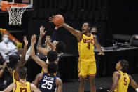 Southern California's Evan Mobley (4) blocks a shot by Connecticut's James Bouknight during the second half of an NCAA college basketball game Thursday, Dec. 3, 2020, in Uncasville, Conn. (AP Photo/Jessica Hill)