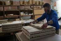 The company, which has just 14 employees, was founded in the 1950s to supply veneer -- or slender pieces of wood -- for furniture, but a decade later it also expanded into making chessboards