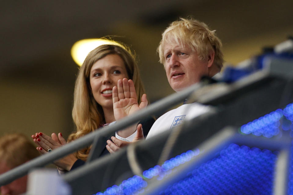 British Prime Minister Boris Johnson and his wife Carrie watch the Euro 2020 soccer championship final between England and Italy at Wembley stadium in London, Sunday, July 11, 2021. (John Sibley/Pool Photo via AP)