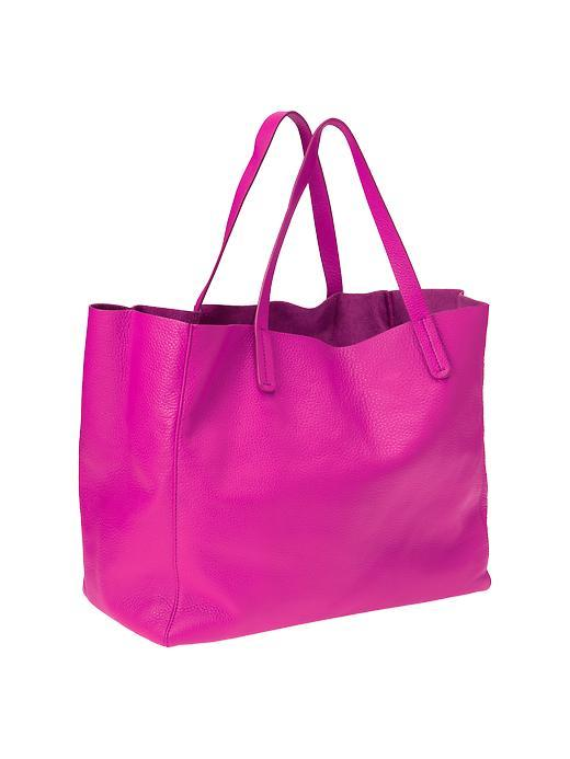 """<div class=""""caption-credit""""> Photo by: Gap</div><div class=""""caption-title""""></div><b>Large Tote <br></b> A large tote to carry to the beach or the park is an absolute must! I love this neon magenta leather one from the Gap (although it's also available in neon yellow, purple rave, skater blue, new vermillion, and camel). <br> <a rel=""""nofollow"""" href=""""http://blogs.babble.com/family-style/2012/11/12/7-handbags-every-woman-must-own/#large-tote"""" target=""""""""><i>Get it here</i></a> <br> <b><i><a rel=""""nofollow"""" href=""""http://blogs.babble.com/babble-voices/about-love-mara-kofoed/2012/08/30/7-items-to-get-rid-of-from-your-wardrobe/?cmp=ELP