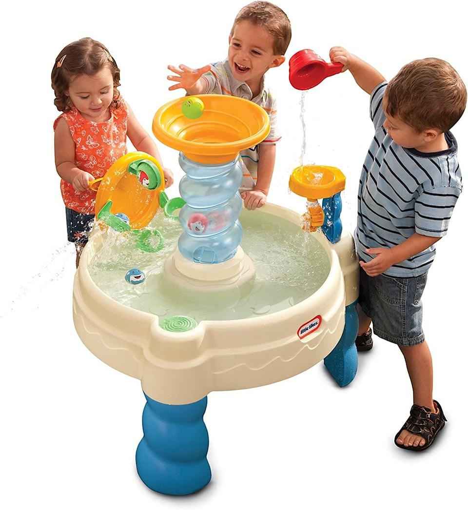 "<p>Summertime just got much more fun with this <a href=""https://www.popsugar.com/buy/Little-Tikes-Spiralin-Seas-Waterpark-Water-Tablebr-575819?p_name=Little%20Tikes%20Spiralin%27%20Seas%20Waterpark%20Water%20Table%3Cbr%3E&retailer=amazon.com&pid=575819&evar1=moms%3Aus&evar9=25800161&evar98=https%3A%2F%2Fwww.popsugar.com%2Fphoto-gallery%2F25800161%2Fimage%2F44870045%2FLittle-Tikes-Spiralin-Seas-Waterpark-Water-Table&list1=gifts%2Camazon%2Choliday%2Ctoys%2Cgift%20guide%2Cparenting%2Cbabies%2Cgifts%20for%20kids%2Ckid%20shopping%2Choliday%20living%2Choliday%20for%20kids%2Cgifts%20for%20toddlers%2Cbest%20of%202019&prop13=api&pdata=1"" class=""link rapid-noclick-resp"" rel=""nofollow noopener"" target=""_blank"" data-ylk=""slk:Little Tikes Spiralin' Seas Waterpark Water Table"">Little Tikes Spiralin' Seas Waterpark Water Table<br> </a> ($44).</p>"
