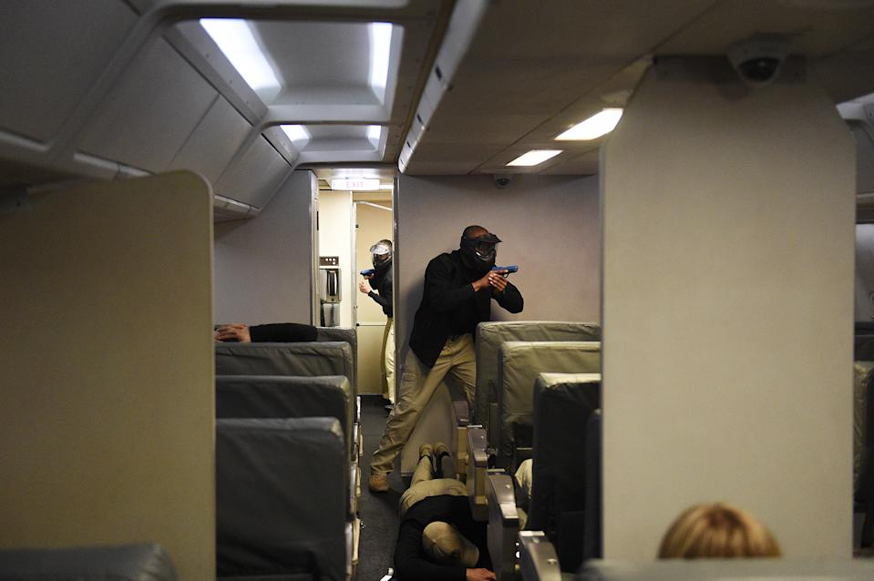 A terrorist attack inside a remake of a commercial Boing 767 passenger airplane is simulated during a training practice for future federal air marshals