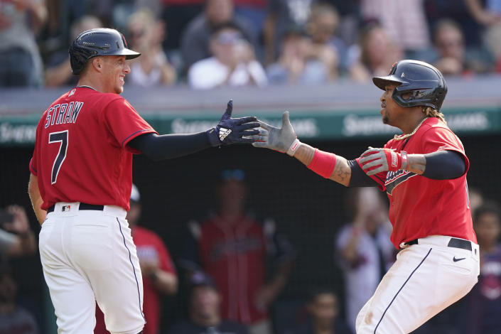 Cleveland Indians' Jose Ramirez, right, is congratulated by Myles Straw after hitting a three-run home run in the third inning of a baseball game against the Los Angeles Angels, Saturday, Aug. 21, 2021, in Cleveland. (AP Photo/Tony Dejak)
