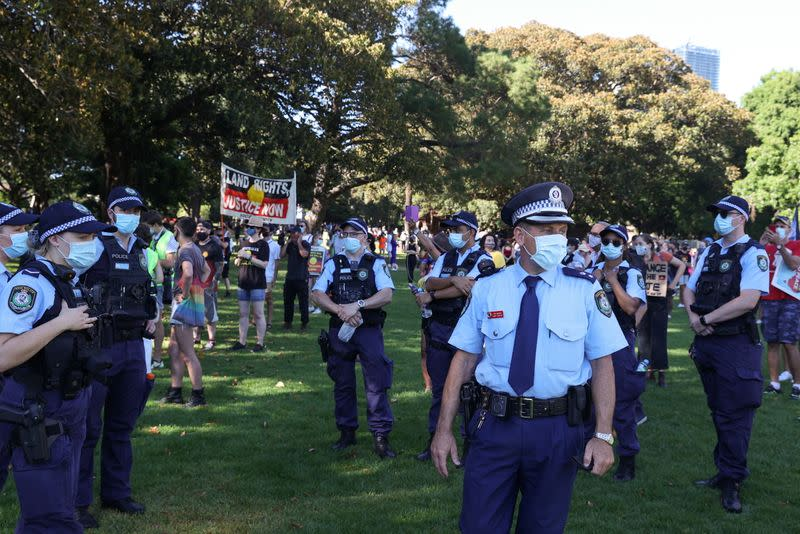 Police are seen as protesters gather on Australia Day in Sydney