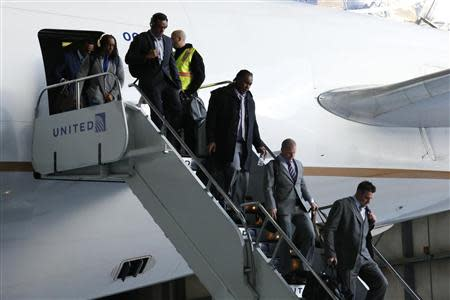 Denver Broncos players arrive at the Newark International Airport to finish off their preparations for the 48th Super Bowl against the Seattle Seahawks, in New Jersey, January 26, 2014. REUTERS/Eduardo Munoz