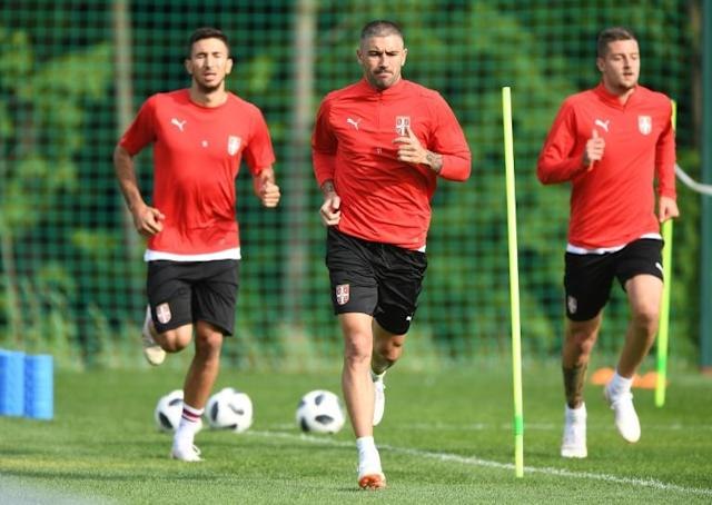 Serbia's (from L) Marko Grujic, Aleksandar Kolarov and Sergej Milinkovic-Savic take part in a training session in Svetlogorsk, north of Kaliningrad, on June 19, during of the Russia 2018 World Cup football tournament