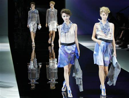 Models present creations from the Giorgio Armani Spring/Summer 2014 collection during Milan Fashion Week