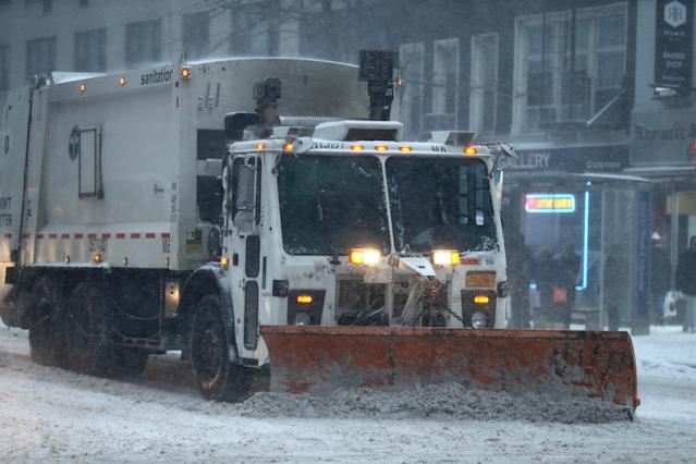 <p>A NYC sanitation snowplow clears snow on E. 57th St. in New York City on Thursday, Jan. 4, 2018, as a powerful winter storm buffeted the area with high winds and blowing snow. (Photo: Gordon Donovan/Yahoo News) </p>