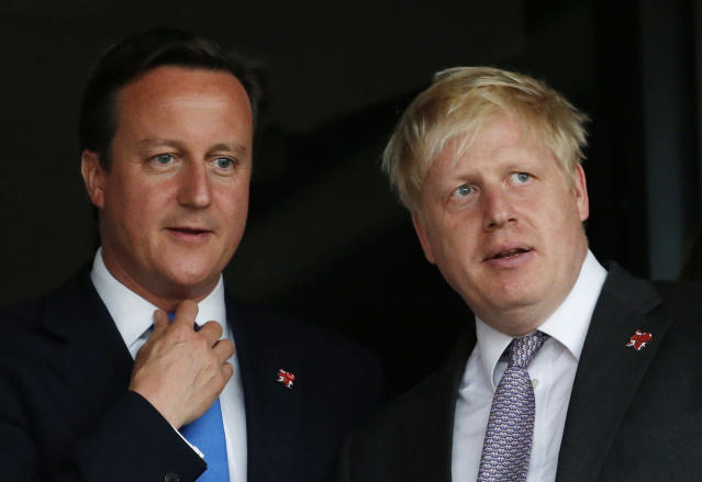 Britain's Prime Minister David Cameron, left, and London's Mayor Boris Johnson wait for the start of the Opening Ceremony at the 2012 Summer Olympics, Friday, July 27, 2012, in London. (AP Photo/Jae C. Hong)