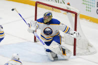 Buffalo Sabres goaltender Jonas Johansson deflects a shot during the third period of the team's NHL hockey game against the New York Islanders on Thursday, March 4, 2021, in Uniondale, N.Y. (AP Photo/Frank Franklin II)