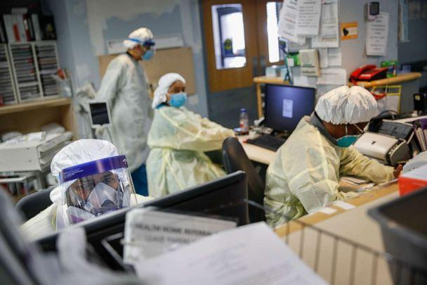 PHOTO: Emergency room doctors and nurses wear personal protective equipment while manning desks due to COVID-19 concerns at St. Joseph's Hospital, April 20, 2020, in Yonkers, N.Y. (John Minchillo/AP, FILE)