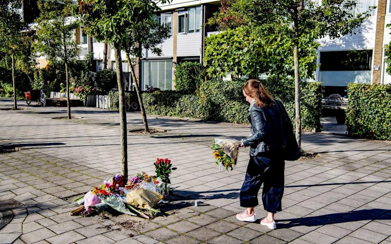 Flowers were left at the home of the murdered lawyer as news of the gangland-style killing spread. - REX