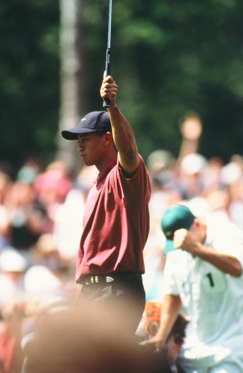 Tiger Woods Celebrates His Putt During The 2002 Masters Tournament (Photo by Augusta National/Getty Images)