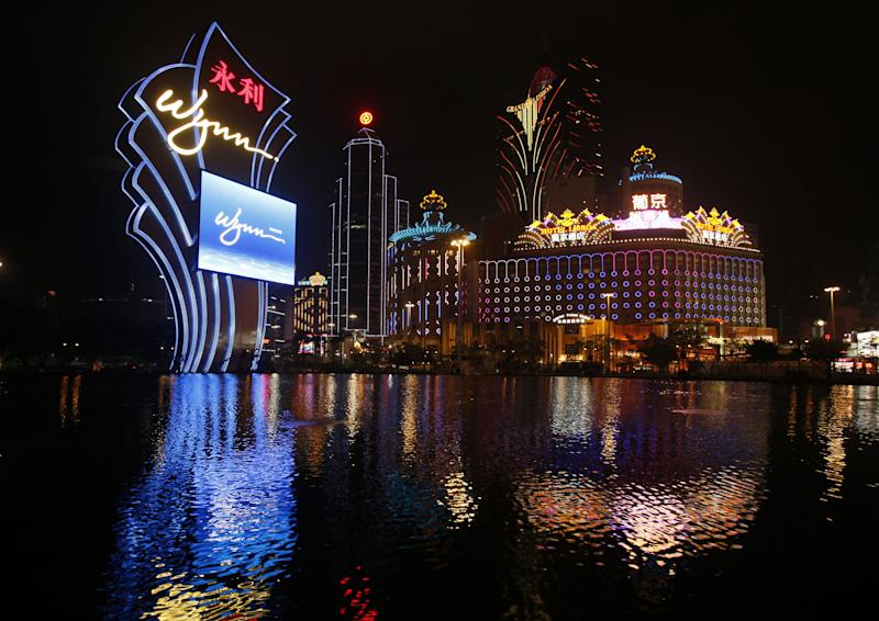 """FILE - In this Thursday April 22, 2010 file photo, the Wynn Macau is lit up. The Chinese arm of Wynn Resorts Ltd. said it received approval on Wednesday, May 2, 2012 for a new casino in the Cotai district of Macau, the world's most lucrative gambling market. Wynn Resorts founder, chairman and CEO Steve Wynn said the Cotai development is the """"single most important project"""" in his company's history. (AP Photo/Kin Cheung, File)"""
