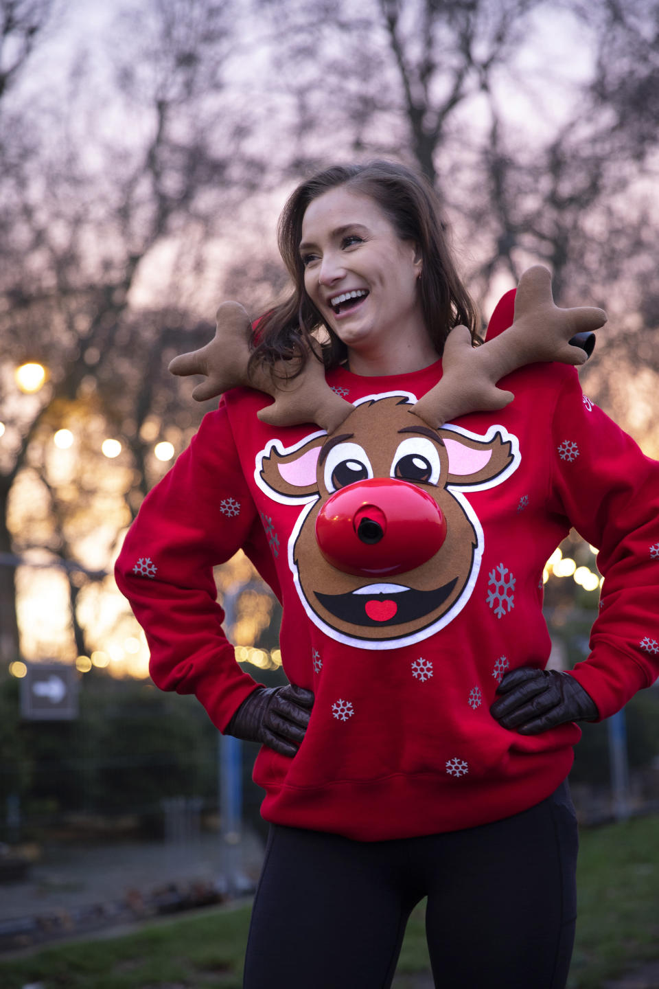 Ford creates Christmas jumper that projects safe distance