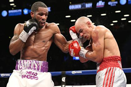 Lamont Peterson, left, lands a left hook during his win over Edgar Santana. (Getty Images)