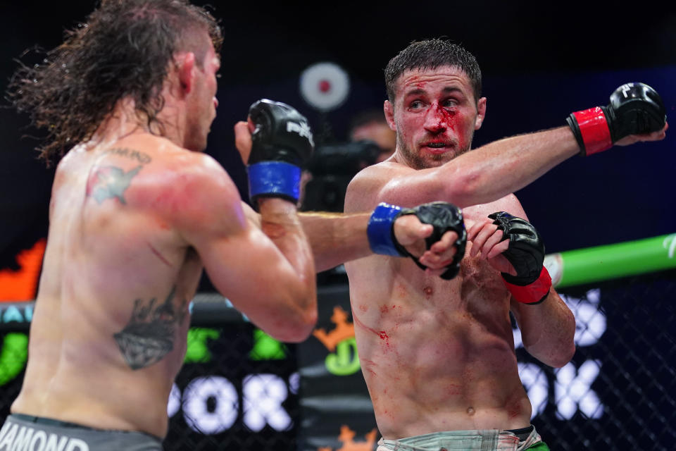Brendan Loughnane, right, follows through on a right to Tyler Diamond during a Professional Fighters League mixed martial arts bout in Atlantic City, N.J., Thursday, June 10, 2021. (AP Photo/Matt Rourke)