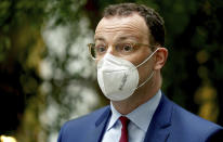 German Health Minister Jens Spahn arrives for a press conference in Berlin, Germany, Wednesday, May 12, 2021. (AP Photo/Michael Sohn)