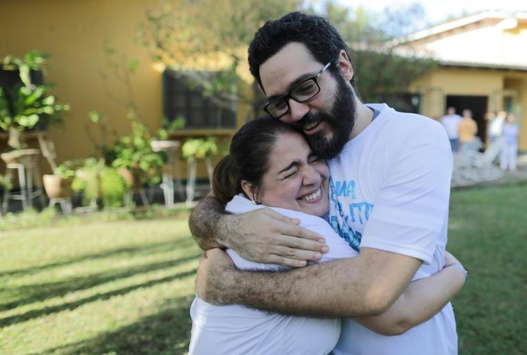 """Jesus Tefel (R) embraces a friend after been released from """"El Chipote"""" prison"""