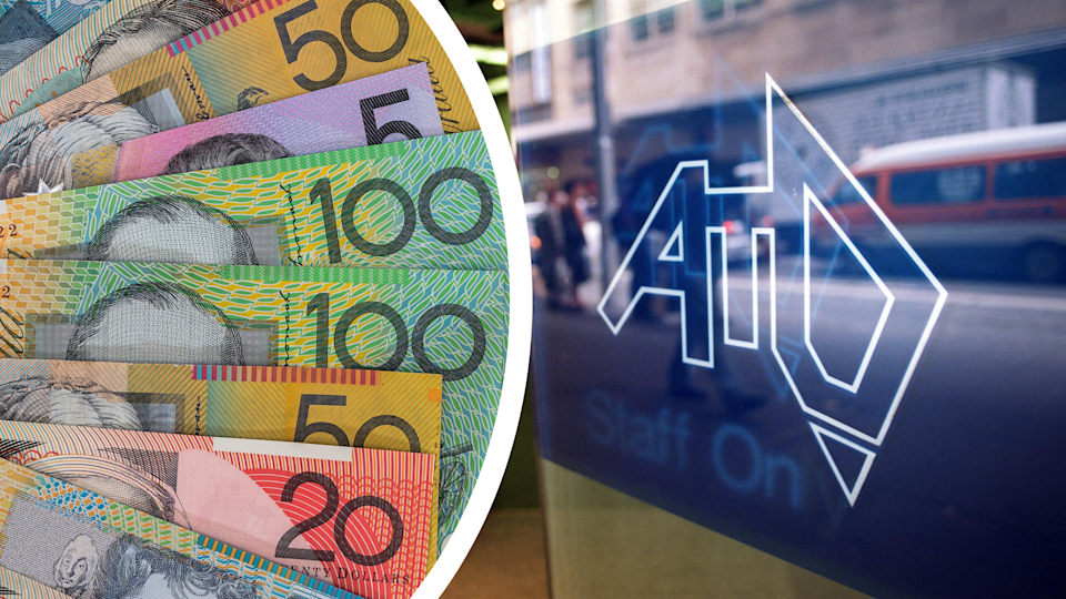 Australian currency and the ATO logo on the door of the ATO building.