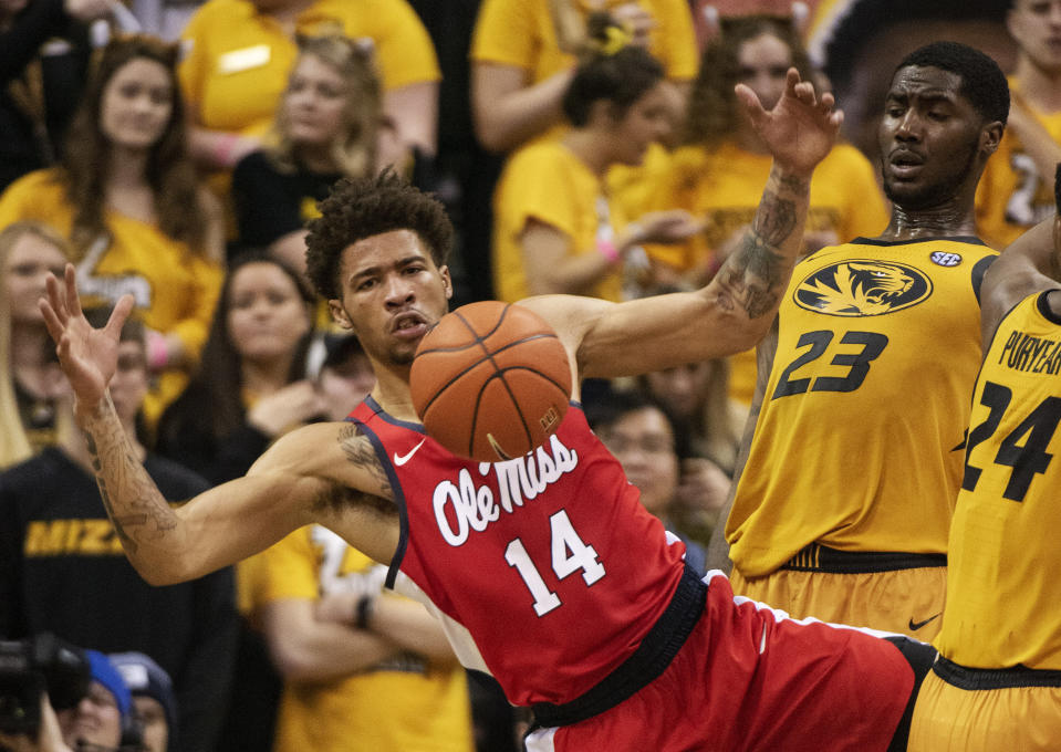 Mississippi's KJ Buffen, left, looses control of the ball in front of Missouri's Jeremiah Tilmon, right, during the second half of an NCAA college basketball game Saturday, March 9, 2019, in Columbia, Mo. Mississippi won the game 73-68. (AP Photo/L.G. Patterson)