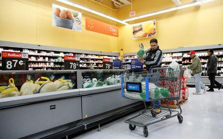 FILE PHOTO: A customer shops for a turkey at a Walmart store in Chicago, Illinois, U.S., November 20, 2018. REUTERS/Kamil Krzaczynski/File Photo