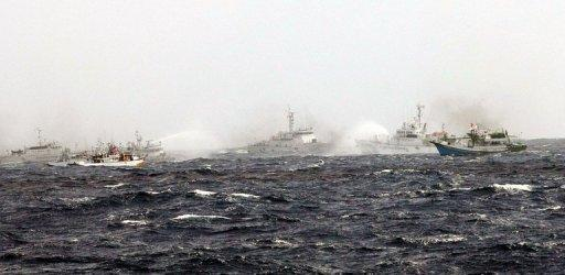 This image received from Taiwan's CNA shows Japan Coast Guard patrol boats (far L and 2nd R) alongside a Taiwan Coast Guard boat (C) duelling with water cannon, as they enter Tokyo-controlled waters. The boats are part of a fleet that left Taiwan a day earlier, vowing to stake their claim to disputed islands where they say they have ancestral fishing rights