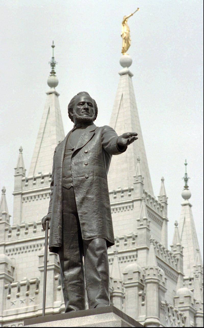 FILE - In this April 1, 1998 file photo, a statue of Mormon pioneer leader Brigham Young stands in front of The Church of Jesus Christ of Latter-day Saints' Temple in Salt Lake City. Latter-day Saints are anxious about what's ahead. Republican Mitt Romney is about to become the first Mormon nominee for U.S. president on a major party ticket, giving Mormons a chance like no other to explain their tradition to the public. But the church's many critics will have a bigger platform, too. And the vetting will take place amid the emotion of what observers expect will be a nasty general election. (AP Photo/Douglas C. Pizac, File)